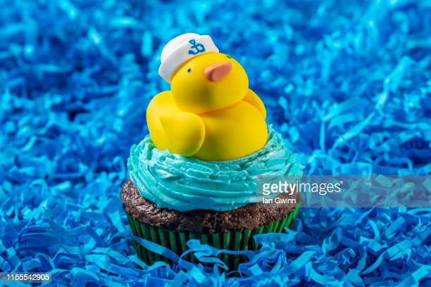 rubber ducky cupcake - ian gwinn stock photos and pictures