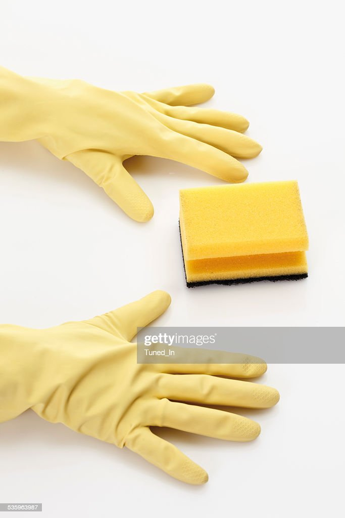 Rubber gloves and sponge on white background, close up : Stock Photo