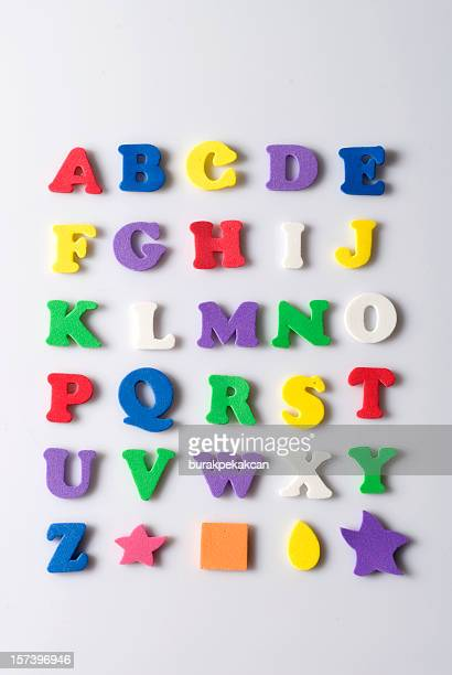 Rubber letters and shapes on white background