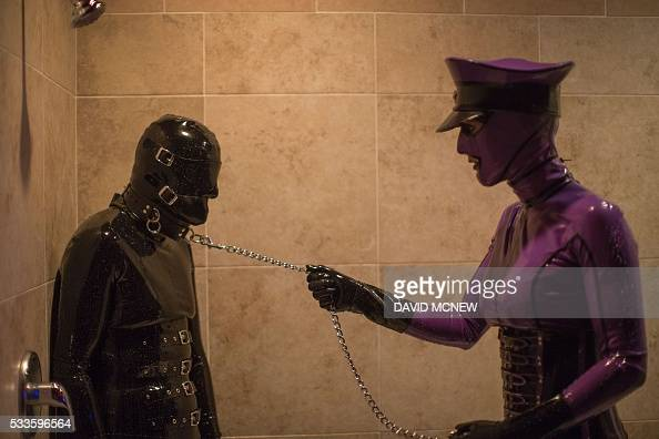 Rubber Lynn Is Dominated By Jenna Latex In A Shower At A