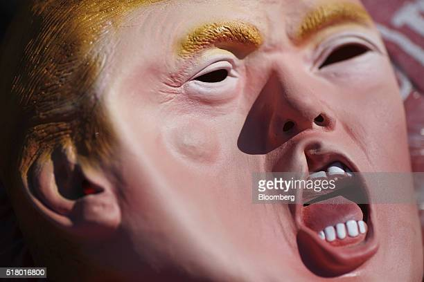 A rubber mask in the likeness of Donald Trump president and chief executive of Trump Organization Inc and 2016 Republican presidential candidate is...