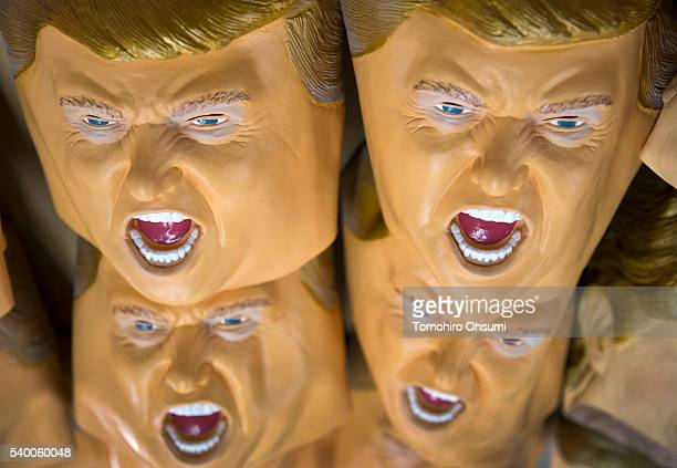 Rubber masks in the likeness of Republican presidential candidate Donald Trump are stacked at the Ozawa Studios Inc factory on June 14 2016 in...