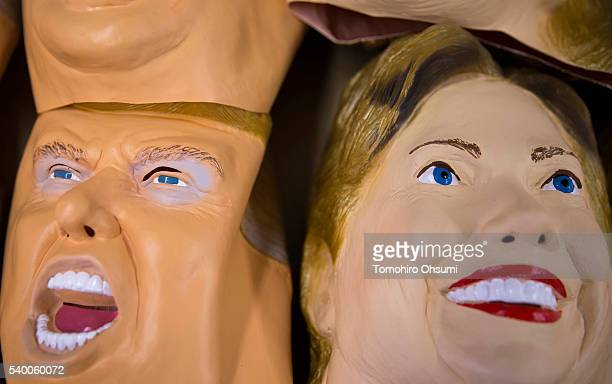 Rubber masks in the likeness of Republican presidential candidate Donald Trump left and Democratic presidential candidate Hillary Clinton are stacked...