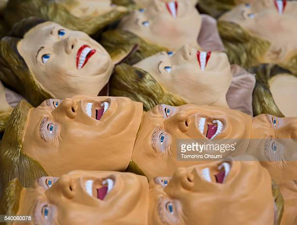 Rubber masks in the likeness of Republican presidential candidate Donald Trump and Democratic presidential candidate Hillary Clinton are stacked at...