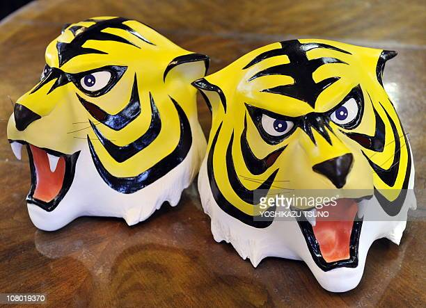 Rubber masks of cartoon character Tiger Mask a masked professional wrestling manga hero is displayed at Japanese toy mask maker Ogawa Rubber's...