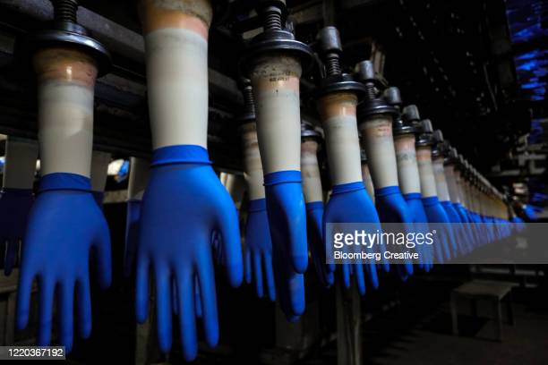 rubber protective gloves - surgical glove stock pictures, royalty-free photos & images