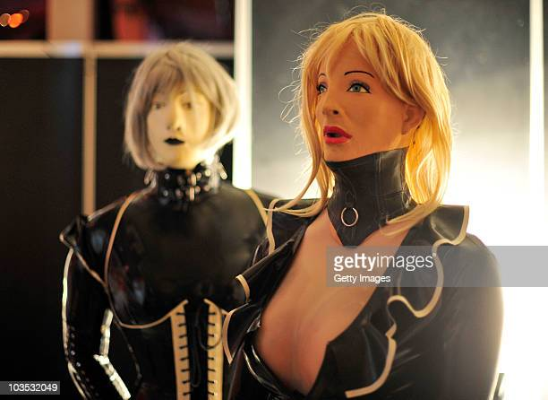 Rubberdolls Latex Yvonne of Germany and Gaelle Lagalle of France wait backstage prior to a RubberdollContest at the Latexpo 2010 at the Edelfettwerk...