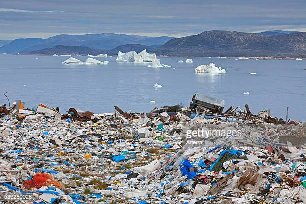 Rubbish at garbage dump and icebergs at Ilulissat / Jakobshavn DiskoBay Greenland