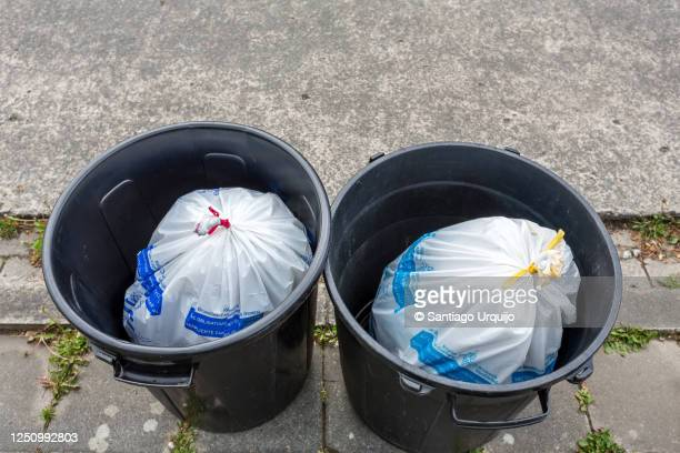 rubbish bins filled with waste bags - garbage can stock pictures, royalty-free photos & images