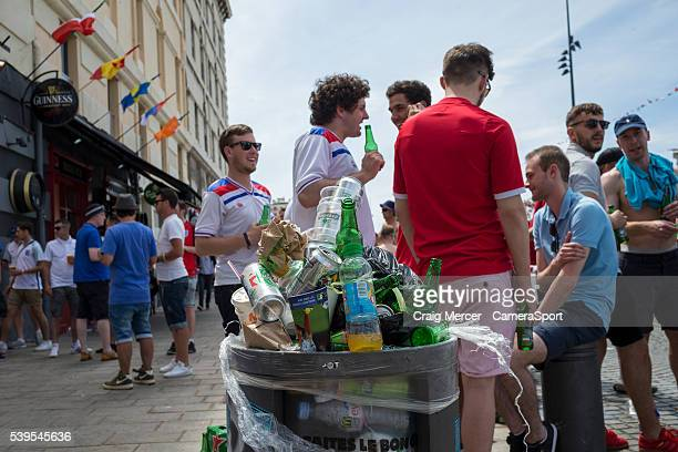 Rubbish bins overflow with beer can and bottles as England fans enjoy the prematch build up in Marseille old town prior to the UEFA Euro 2016 Group B...