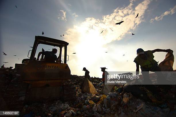 Rubbish collectors at Jardim Gramacho the biggest open air garbage dump in Latin American on its closing day on May 31 2012 in Rio de Janeiro Brazil...