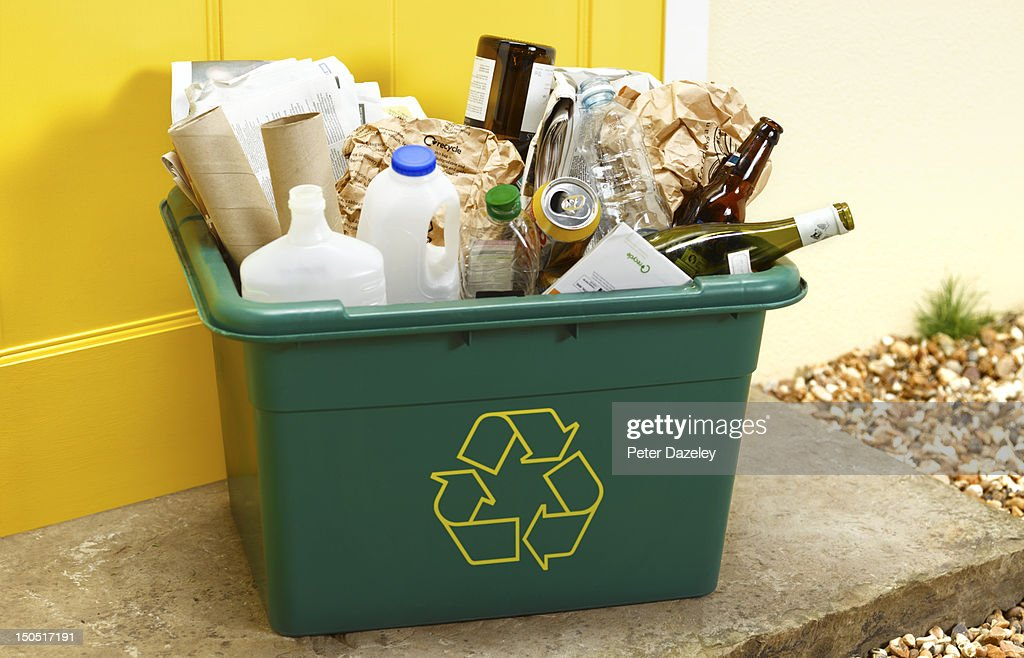 Rubbish for recycling on a doorstep for collection : Stock Photo