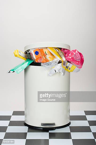 rubbish in a bin - garbage bin stock pictures, royalty-free photos & images
