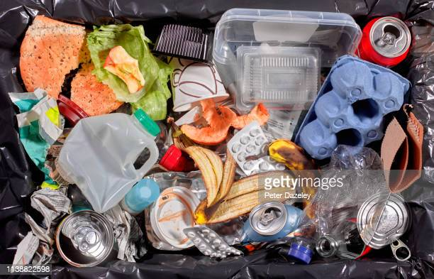 rubbish in bin unsorted - rubbish stock pictures, royalty-free photos & images