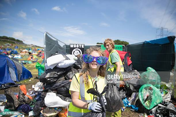 Rubbish is collected at the Glastonbury Festival 2016 at Worthy Farm Pilton on June 26 2016 near Glastonbury England The Festival which Michael Eavis...