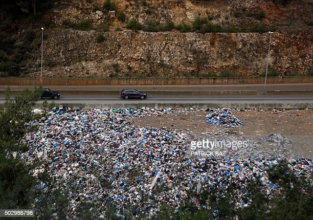 Rubbish is seen piled up on a the side of a highway in Jdeideh northeast of Beirut on December 31 2015 AFP PHOTO / PATRICK BAZ / AFP / PATRICK BAZ