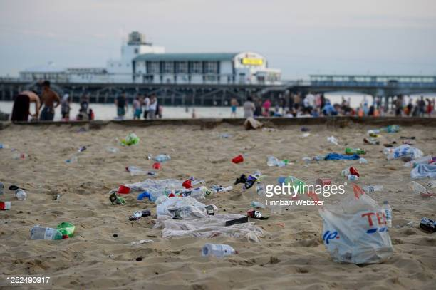 Rubbish litters the beach after many visitors leave on June 25, 2020 in Bournemouth, United Kingdom. A major incident was declared by the local...