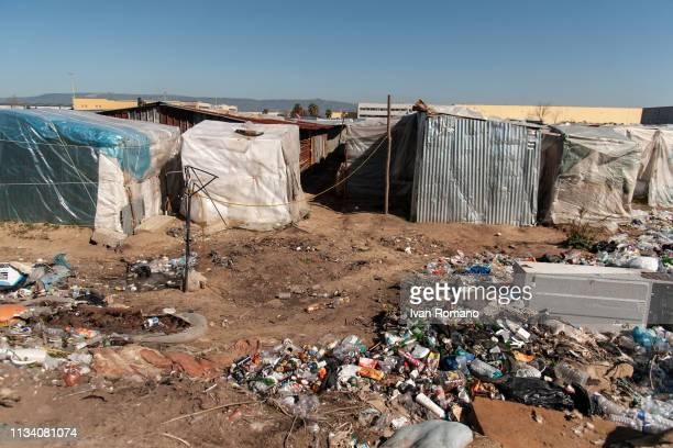 Rubbish outside of tents as police officers evict refugees from the shanty town of San Ferdinando on March 6 2019 in Reggio Calabria Italy The camp...