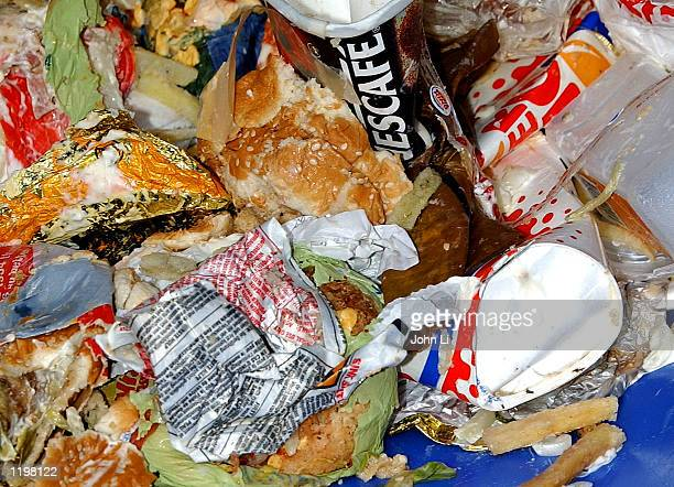 Rubbish overflows from a fast food restaurant's waste bin August 1 2002 in central London The 'Keep Britain Tidy' campaign has warned that the rat...