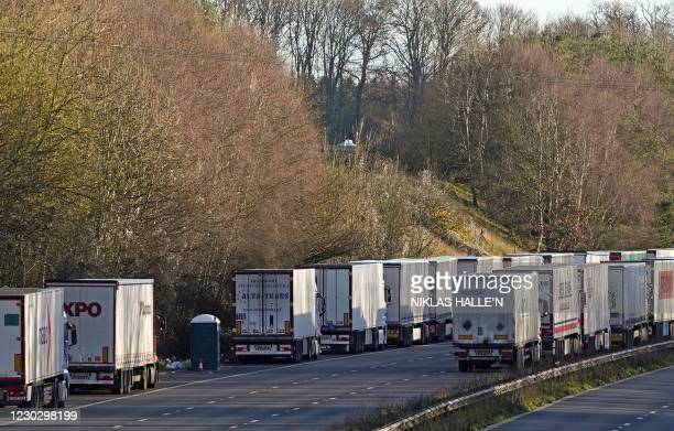 Rubbish surrounds a single portaloo toilet facility stood between freight lorries queued up on the M20 motorway, southbound, leading to the Port of...