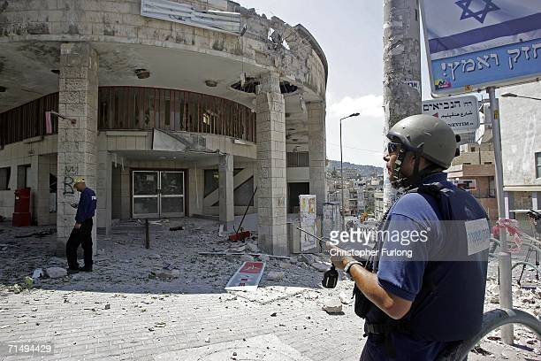 Rubble and debris is strewn across the street in the Hadar district after a Hezbollah missile strike on July 21 2006 in Haifa Israel Haifa was struck...