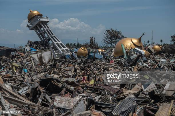 Rubble and debris lie around the ruins of a mosque following an earthquake on October 02 2018 in Palu Indonesia Indonesias disaster response agency...