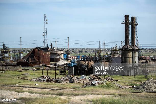 Rubble and debris lies on the ground around an oil refinery destroyed by retreating Islamic State fighters at the beginning of the Mosul offensive on...