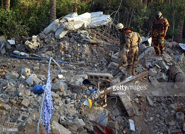 Rubble and debris litter the site of the safe house where Abu Musab alZarqawi was killed the night before in an airstrike by US warplanes June 8 2006...