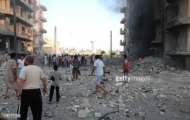 Rubble and debris litter the street following an explosion in the northern Syrian city of Raqqa early on August 7 2013 UN weapons inspectors tasked...