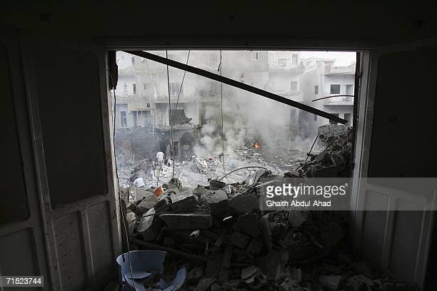 Rubble and debris smolders as local Lebanese try to extinguish a fire after an Israeli air strike hit a cultural centre affiliated with Hezbollah...
