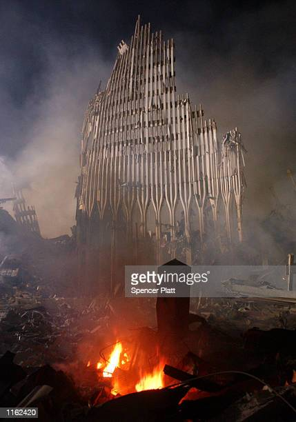 Rubble burns at the remains of the destroyed World Trade Center towers September 12, 2001 in New York City one day after the twin towers were...