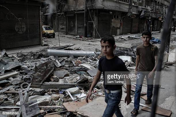 Rubble fills a street in Sha'ar Aleppo on June 3 2014 A nearby building was hit in a barrel bomb attack that killed 15 people on June 1