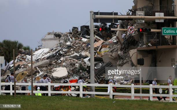 Rubble is piled high after the partial collapse of the 12-story Champlain Towers South condo building on June 24, 2021 in Surfside, Florida. It is...