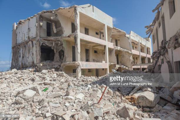 rubble of destroyed buildings - rubble stock photos and pictures