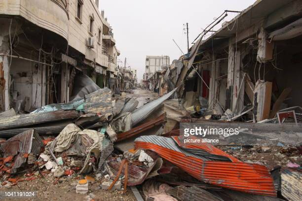 Rubble on a street in Kobane Syria 30 January 2015 The Kurds have recaptured the city though the price is very high The extremists' heavy artillery...