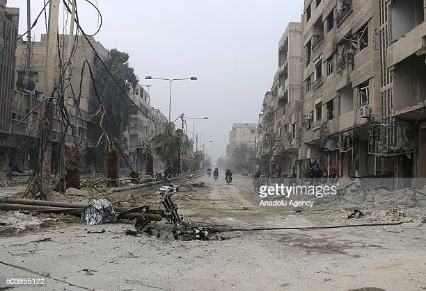Rubbles of buildings are seen after the Russian airstrikes targeted residential areas in opposition controlled Eastern Ghouta region of Damascus...