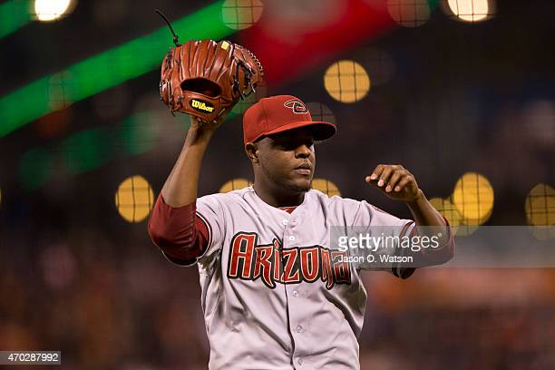 Rubby De La Rosa of the Arizona Diamondbacks returns to the dugout after being relieved against the San Francisco Giants during the seventh inning at...