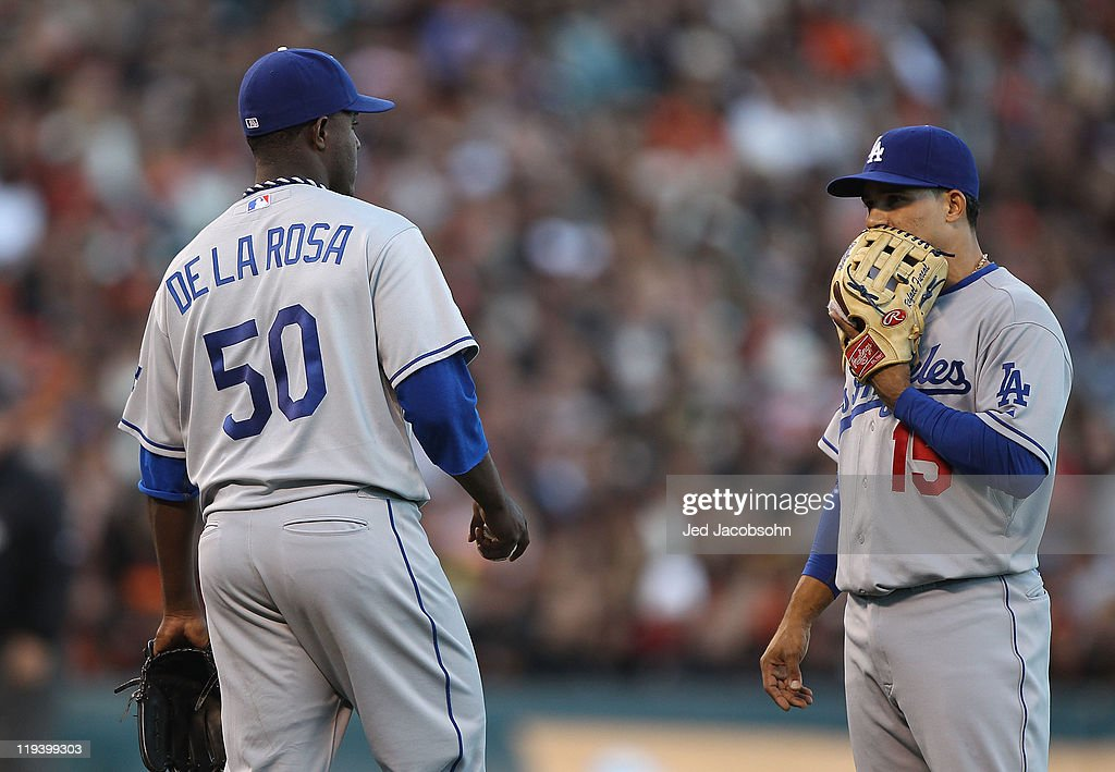 Rubby De La Rosa #50 of the Los Angeles Dodgers talks with teammate Rafael Furcal #15 after giving up two runs in the second inning against the San Francisco Giants at AT&T Park on July 19, 2011 in San Francisco, California.