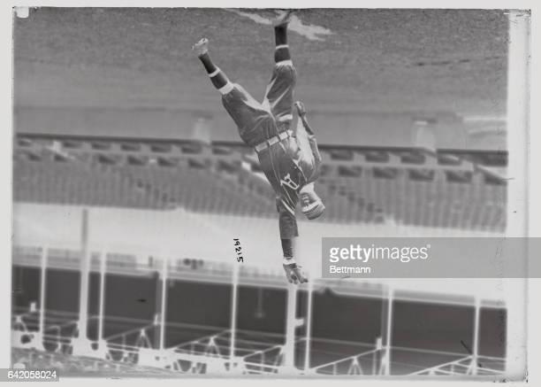 Rube Oldring leftfielder for the Philadelphia Athletics reaching to catch ball