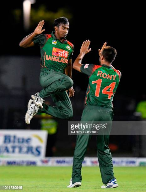 Rubel Hossain and Abu Hider of Bangladesh of celebrate the dismissal Denesh Ramdin of West Indies during the 3rd and final T20i match between West...