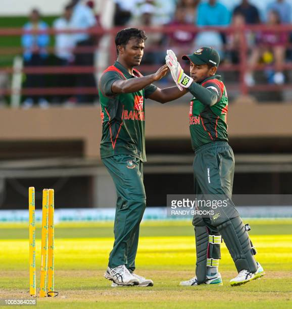 Rubel Hossain and Mushfiqur Rahim of Bangladesh celebrate the dismissal of Rovman Powell of West Indies during the 2nd ODI match between West Indies...
