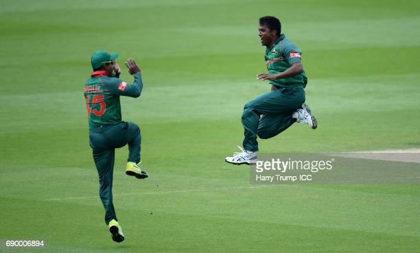 Rubel Hossain of Bangladesh celebrates after dismissing Rohit Sharma of India during the ICC Champions Trophy Warmup match between India and...