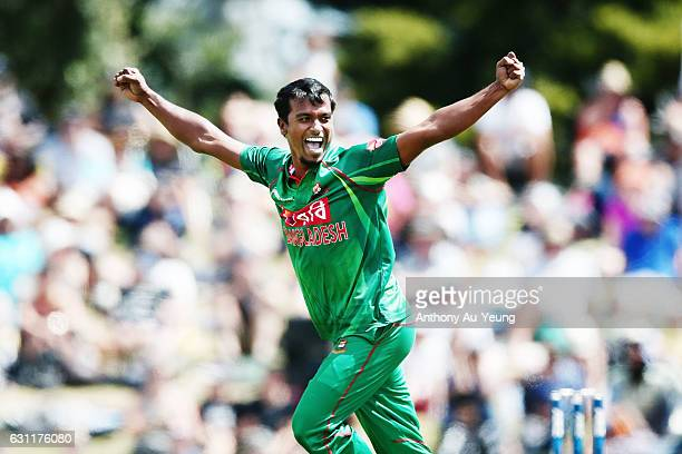Rubel Hossain of Bangladesh celebrates the wicket of Colin Munro of New Zealand during the third Twenty20 International match between New Zealand and...