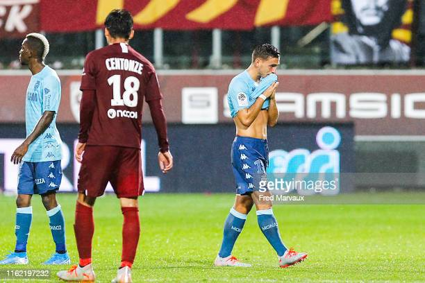 Ruben Aguilar of Monaco receives a red card during the Ligue 1 match between FC Metz and AS Monaco at Stade SaintSymphorien on August 17 2019 in Metz...