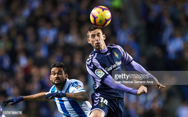 Ruben Alcacer of Real Valladolid CF duels for the ball with Willian Jose Da Silva of Real Sociedad during the La Liga match between Real Sociedad and...