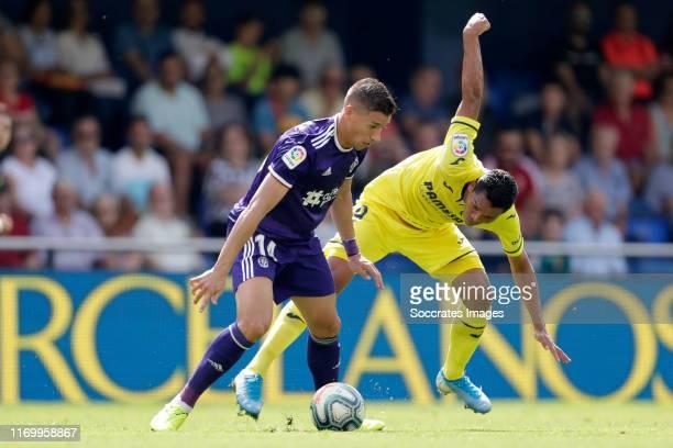 Ruben Alcaraz of Real Valladolid Carlos Bacca of Villarreal during the La Liga Santander match between Villarreal v Real Valladolid at the Estadio de...