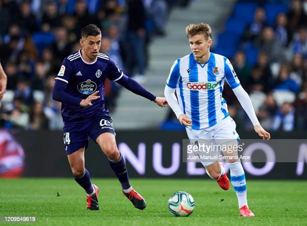Ruben Alcaraz of Real Valladolid CF duels for the ball with Martin Odegaard of Real Sociedad during the Liga match between Real Sociedad and Real...