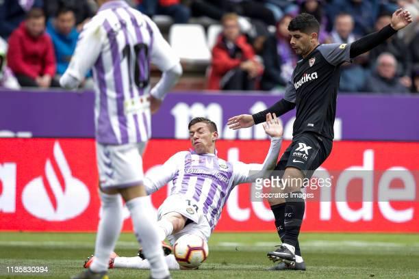 Ruben Alcaraz of Real Valladolidm Ever Banega of Sevilla FC during the La Liga Santander match between Real Valladolid v Sevilla at the Estadio Nuevo...