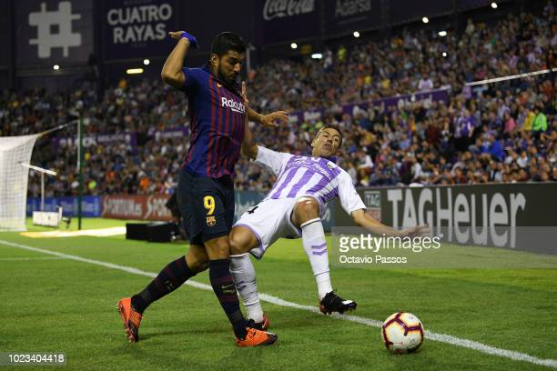 Ruben Alcaraz of Valladolid competes for the ball with Luis Suarez of Barcelona during the La Liga match between Real Valladolid CF and FC Barcelona...
