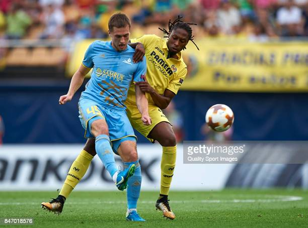Ruben Alfonso Borges Semedo of Villarreal competes for the ball with Roman Murtazayev of Astana during the UEFA Europa League group A match between...